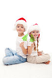 Christmas kids with candy on stick Royalty Free Stock Photos