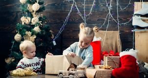 Christmas kids - happiness concept. Children gift. Cute little child near Christmas tree. Portrait kid with gift on royalty free stock images