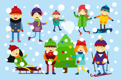 Christmas kids playing winter games Royalty Free Stock Photos
