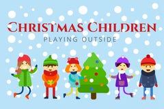 Christmas kids playing winter games. Skating Royalty Free Stock Image