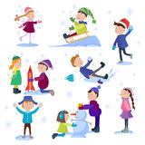 Christmas kids playing winter games Royalty Free Stock Photography