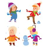 Christmas kids playing winter games Stock Images