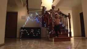 Christmas kids run down staircase. stock video