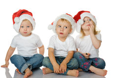 Christmas kids in Santa hat Stock Image