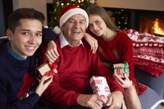 Christmas for kids and their grandfather Stock Photography