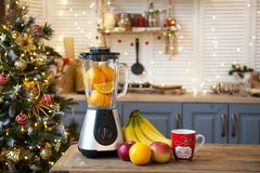 Christmas in the kitchen.Blender with fruit on the table. Copy space stock photo
