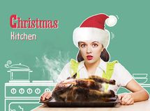Christmas kitchen.Young woman overlooked roast chicken in her ki Royalty Free Stock Photography