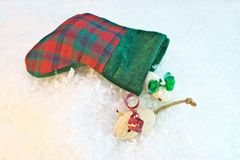 Christmas For Kitty. Small christmas stocking with cat nip mice on snow background Royalty Free Stock Images