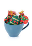 Christmas knick knacks neatly arranged in a cup Stock Photography
