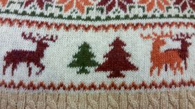 Christmas knitted background. Christmas knit background in red, white, green, orange, beige and brown colors Royalty Free Stock Photography