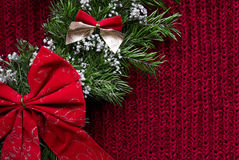 Christmas knitted background with wreath and bows Stock Photo