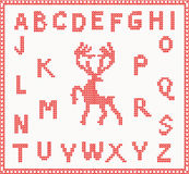 Christmas Knitted Font with Deer in red color Royalty Free Stock Image