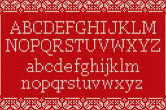 Christmas Knitted Font. Knitted Latin Alphabet on Seamless Backg Stock Photo