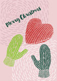 Christmas Knitted gloves and a heart , Christmas card, Merry Christmas wishes Royalty Free Stock Images