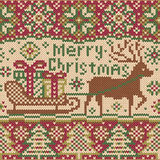 Christmas knitted pattern with reindeer Stock Image