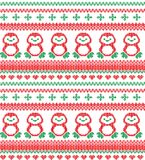 Christmas Knitted Pattern with Reindeer. Christmas festive Norwegian knitted pattern with deer and Christmas trees Royalty Free Stock Images