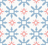 Christmas knitted seamless pattern with blue and red snowflakes Stock Photo