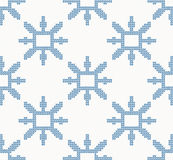 Christmas knitted seamless pattern with blue snowflakes Stock Photos