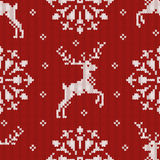 Christmas knitted seamless pattern with a deer and snowflake Stock Photo