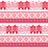 Christmas knitted seamless pattern with town houses, adn snowflakes. Winter red  background - scandynavian city kntting style Stock Images