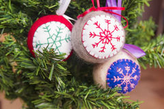 Christmas knitted toys. On the Christmas tree Stock Image