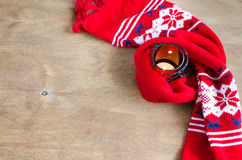 Christmas knitted warm winter scarf and burning candle on rustic wooden background with copy space. Stock Photo