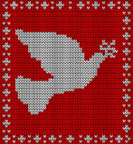 Christmas knitting dove pattern Stock Photo