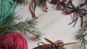 Christmas knitting. In vibrant colors on white wooden background Stock Photography