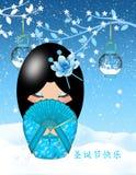 Christmas Kokeshi Doll. Calligraphy says Merry Christmas Royalty Free Stock Photography