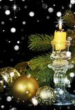 Christmas komposition with a burning candle Stock Image