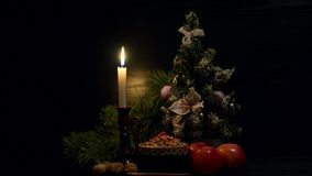 Christmas kutia Traditional Slavic sweet dish Burning candle apples and Christmas tree on a black background stock video