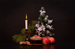 Christmas kutia Traditional Slavic sweet dish. Candle, apples and Christmas tree Stock Image