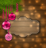 Christmas Label with Balls and Fir Twigs. Illustration Christmas Label with Balls and Fir Twigs on Wooden Texture with Light - vector Royalty Free Stock Images
