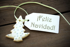 Christmas Label with Feliz Navidad. A Christmas Tree Cookie with a Label with the Spanish Words Feliz Navidad on it which means Merry Christmas stock photo