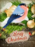 Christmas label on a knitted Bullfinch. EPS 10 Royalty Free Stock Image