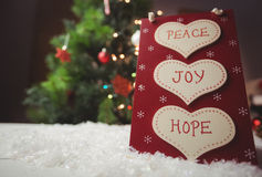 Christmas label with massages of peace, joy and hope Royalty Free Stock Photo