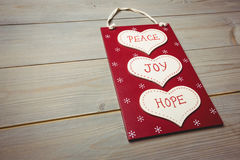 Christmas label with massages of peace, joy and hope Stock Images