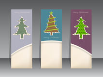 Christmas label set with ripped paper christmastrees Stock Images