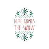 Christmas label with text on white background. Here comes the snow. Typographic element with snowflakes. Vector illustration for seasonal christmas design Royalty Free Stock Photos