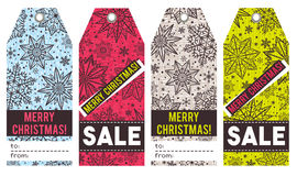 Christmas labels with stars, snowflakes and sale offer, vector Stock Images