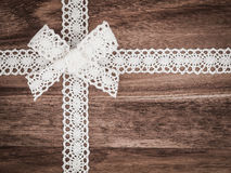 Christmas, lace, present on wood Royalty Free Stock Photos