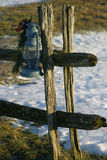 Christmas Lamp. An old oil lamp hanging from a wood fence post, some snow in the background Royalty Free Stock Image