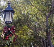 Christmas Lamppost. A beautifully decorated Lamppost reminds those passing by of the Christmas Season Stock Images