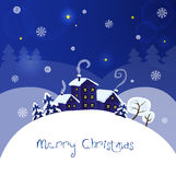 Christmas landscape. Winter festive blue background with the snow and the stars Stock Photos