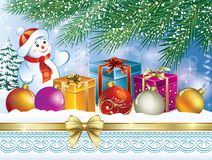 Christmas landscape. With a snowman and Christmas presents Royalty Free Stock Photo