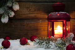 Christmas lantern with baubles on snow. Vintage background Royalty Free Stock Images