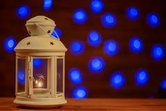 Christmas lantern with burning candle background Stock Images