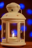 Christmas lantern with burning candle background Stock Image