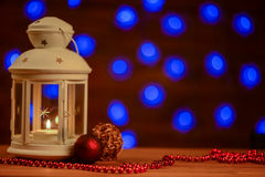 Christmas lantern with burning candle background Royalty Free Stock Photos