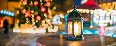 Christmas Lantern With Burning Candle On Bright Blurred Christmas Royalty Free Stock Image